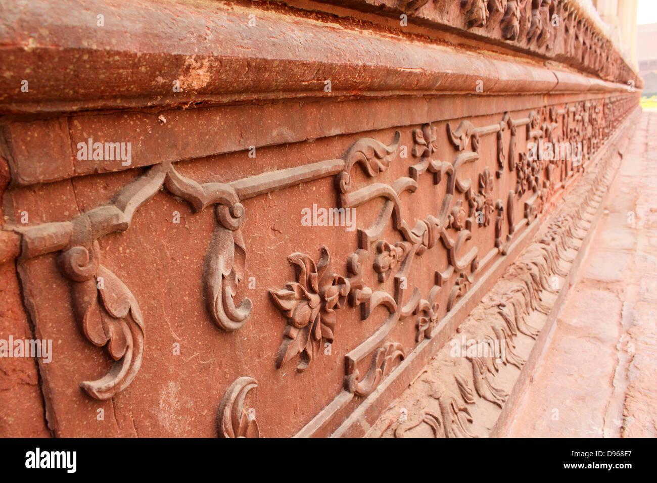 Decorative red brick carvings Agra fort Uttar Pradesh, India - Stock Image