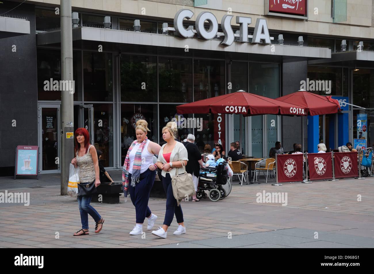 Three Women Walking Past Costa Coffee Shop In St Enoch