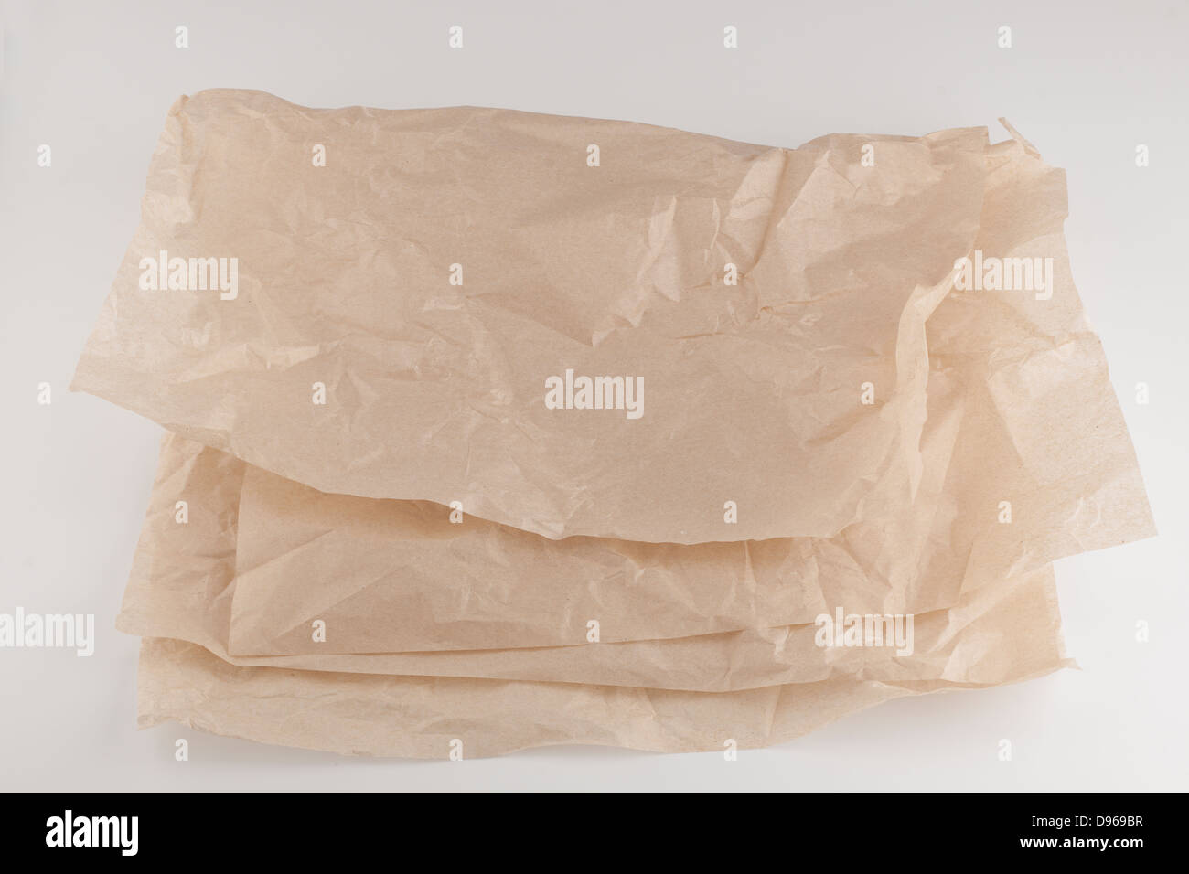 Two thin light sheets of folded brown packing paper - Stock Image