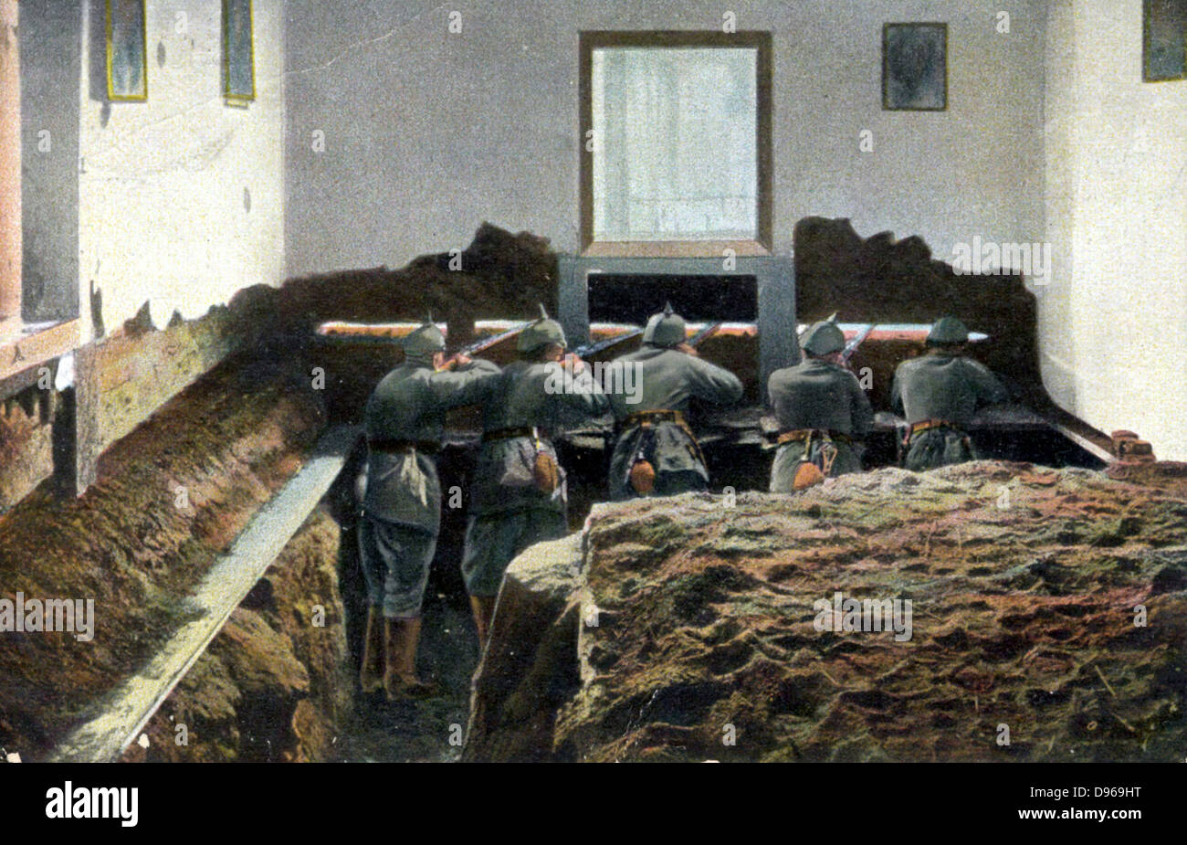 German soldiers in a defensive position in the front room of a house in urban street: World War I. German postcard - Stock Image