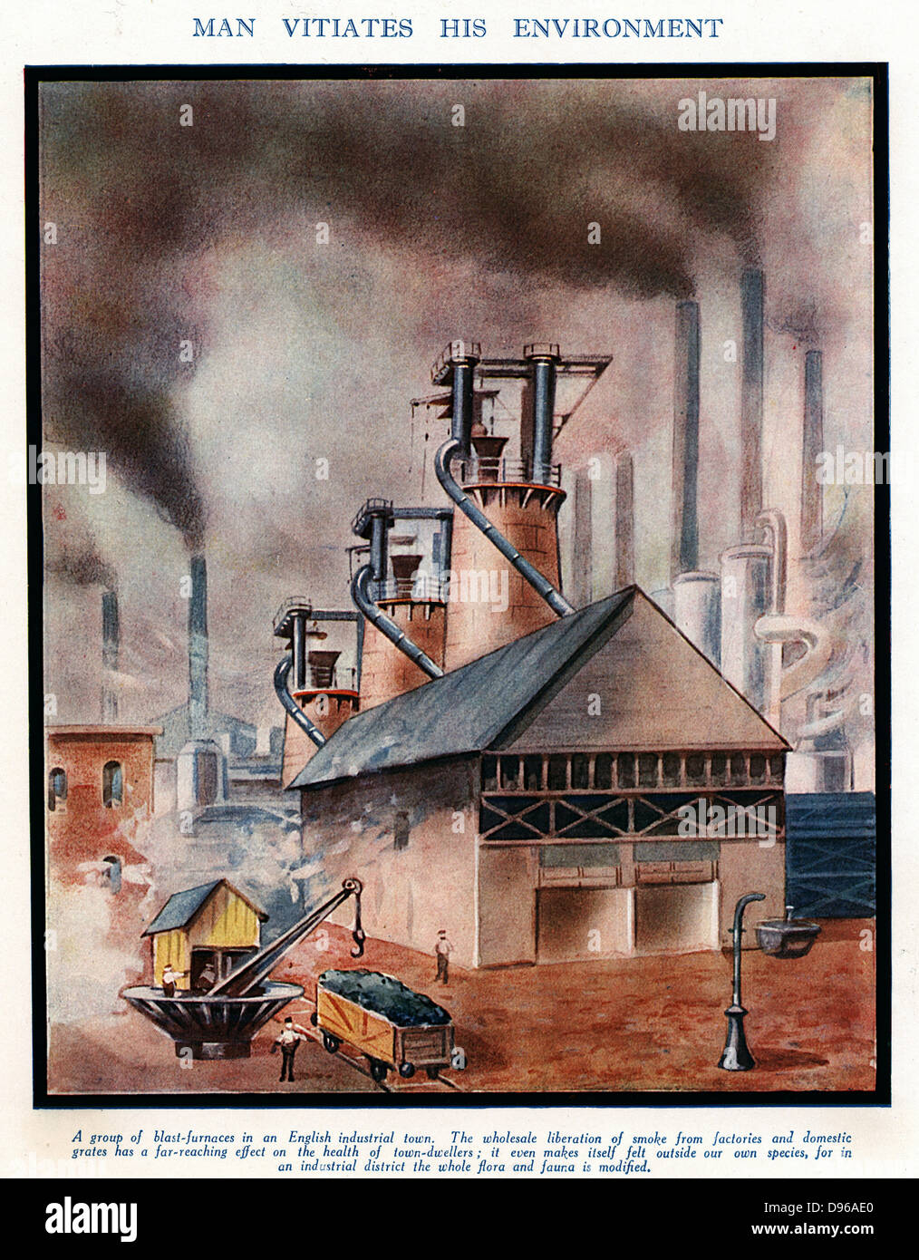 Group of typical early 20th century blast furnaces causing  with smoking chimneys causing atmospheric pollution. - Stock Image