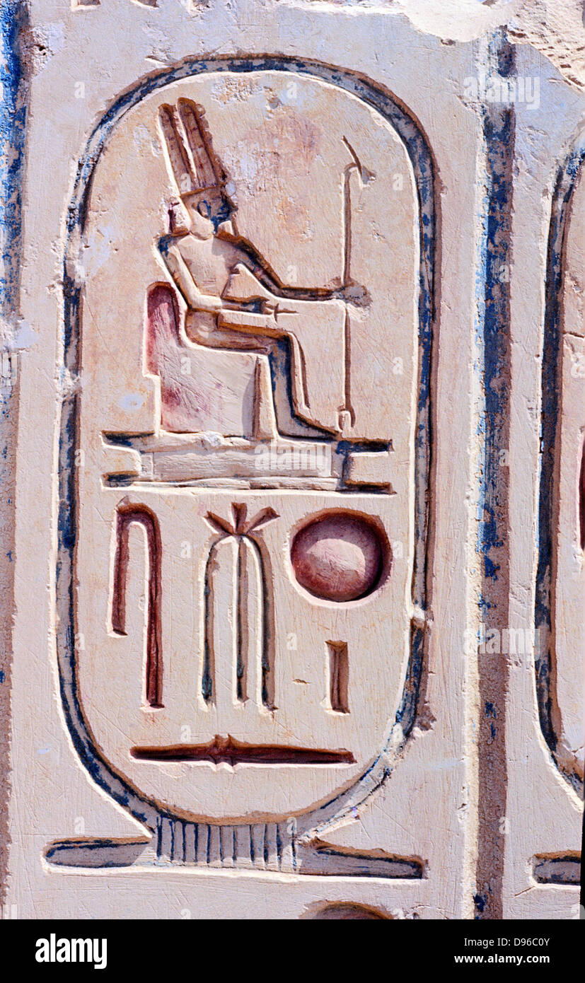 Cartouche carved in stone depicting an Egyptian God - Stock Image