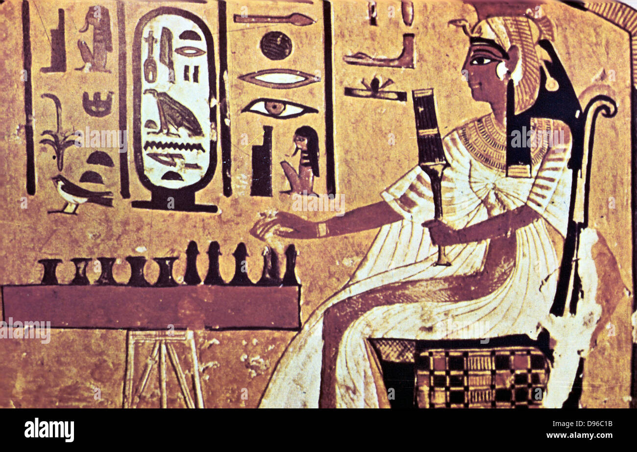 Nefetari, favourite queen of Ramses II (Rameses 1304-12137 BC) seated, playing Senat the Egyptian board game which - Stock Image