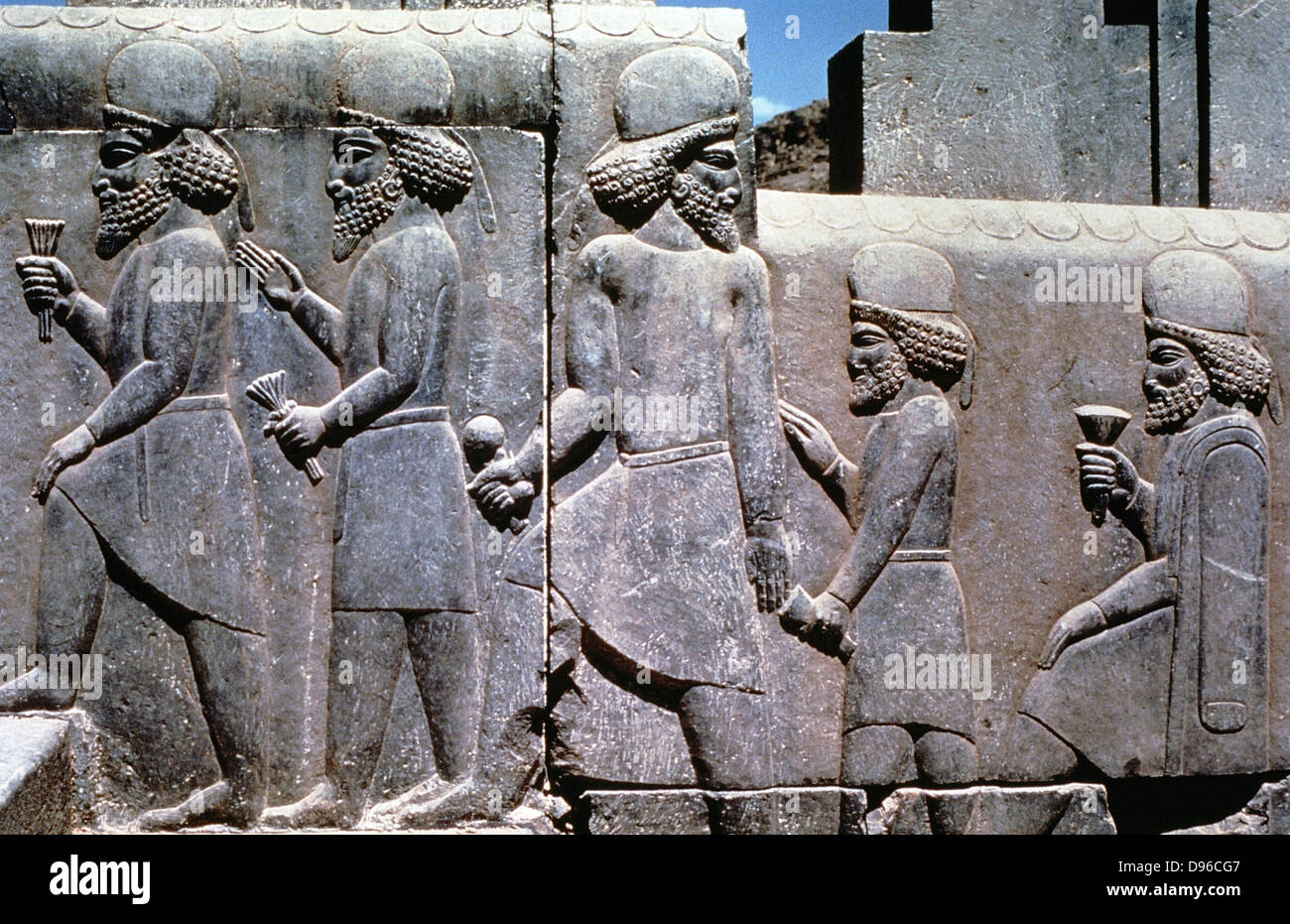 Relief carving on the stairway to the Royal Audience Hall of Darius I (548-486 BC) king of Persia. Subjects bringing - Stock Image
