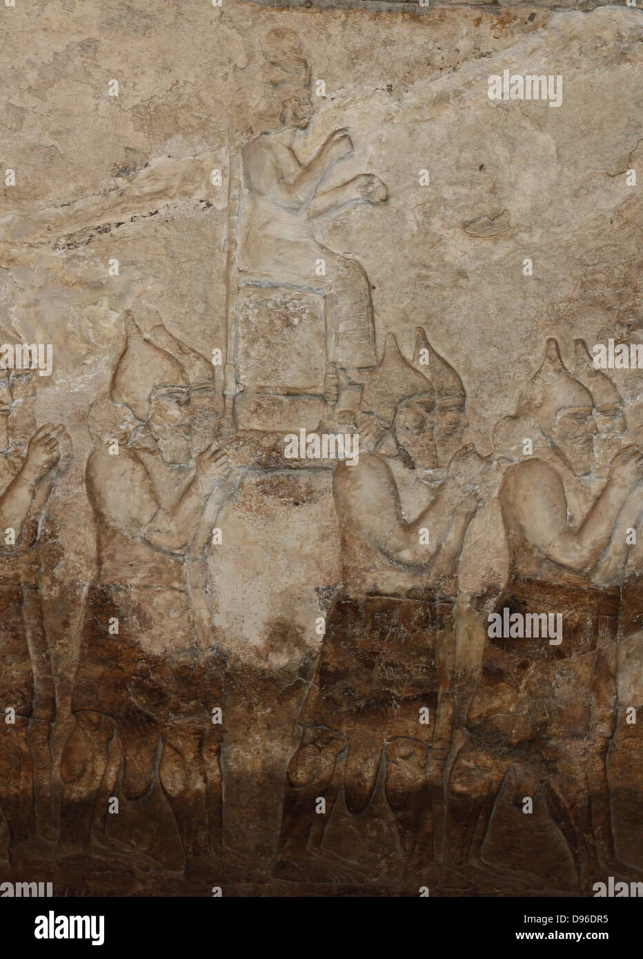 Assyrian wall-panel depicting an attack on an enemy town. Dated approximately 728 BC, from the central palace in - Stock Image