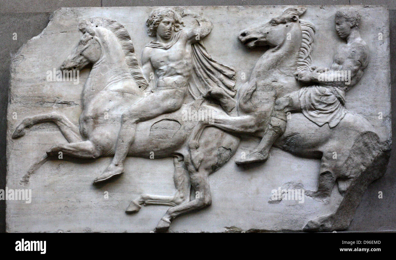 Detail from the Parthenon Frieze. Greek marble sculpture, made between 443-438 BC. The full frieze shows a narrative - Stock Image