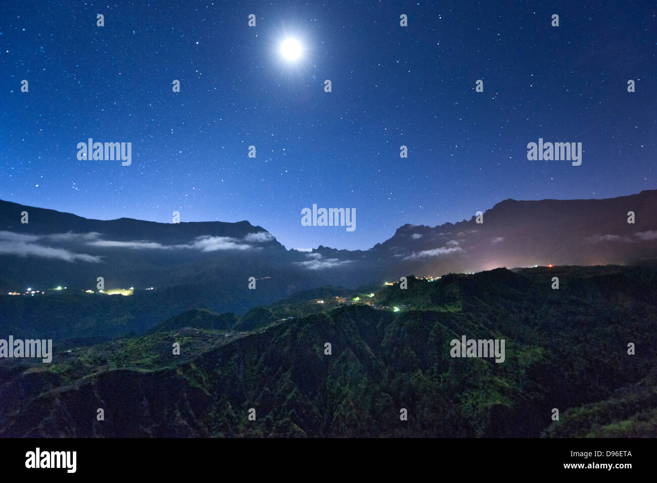 Night view of stars and the moon above the Cirque de Cilaos caldera on the French island of Reunion in the Indian - Stock Image