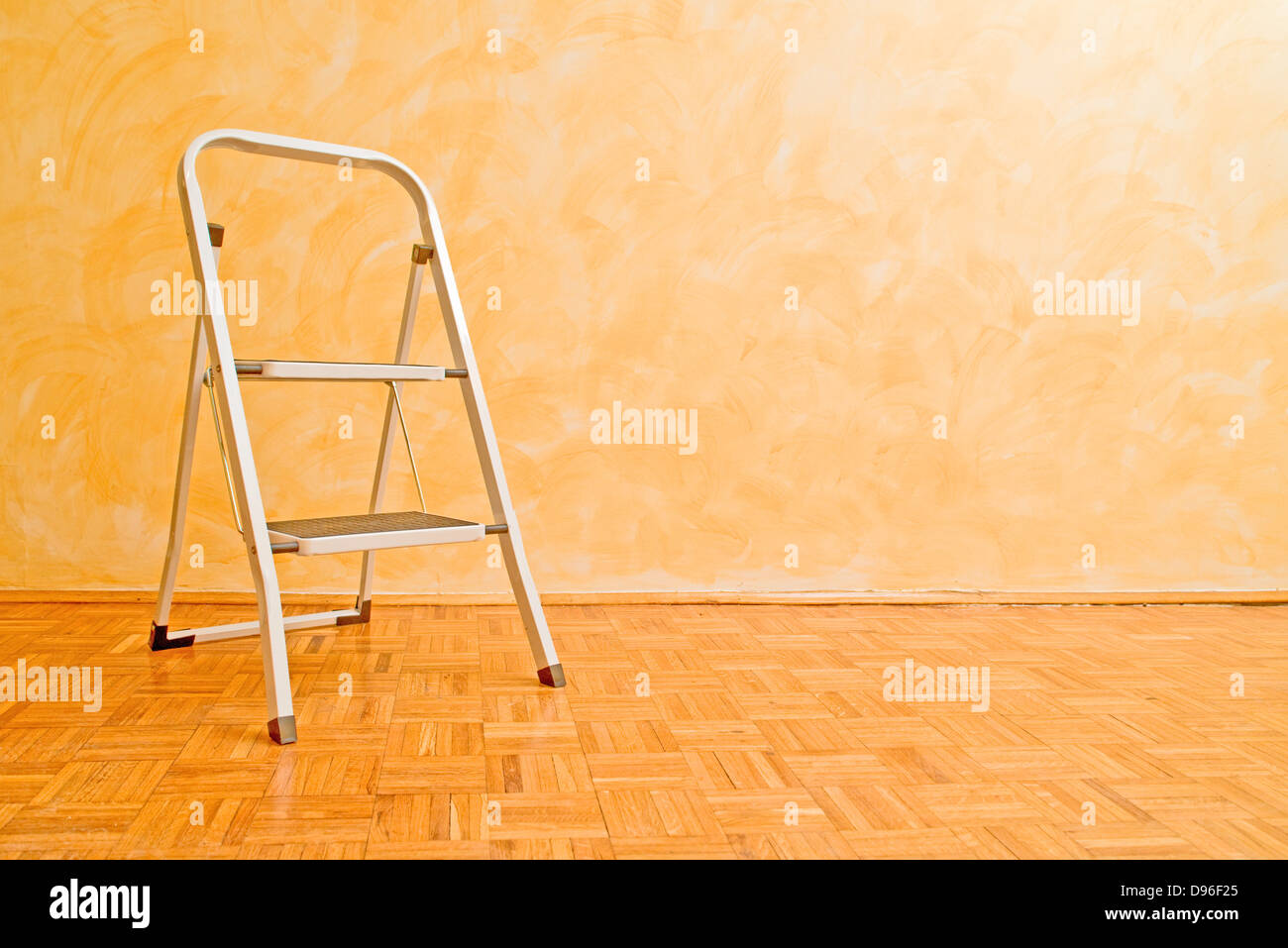 Aluminum ladder in the room, useful for housework. - Stock Image