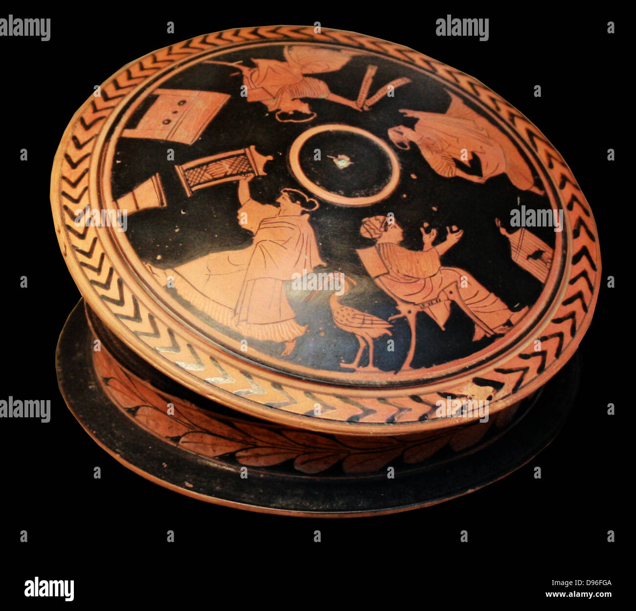 Greek 'pyxis' or trinket-box adorned with red figures. Showing a woman holding a 'sprang' frame. - Stock Image