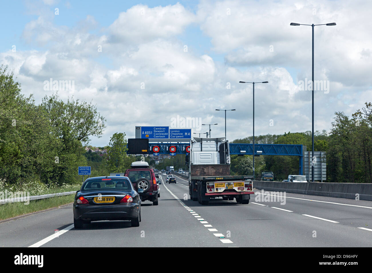 Traffic on the motorway M4 approaching the tunnel at Malpas at Newport, Wales, UK - Stock Image