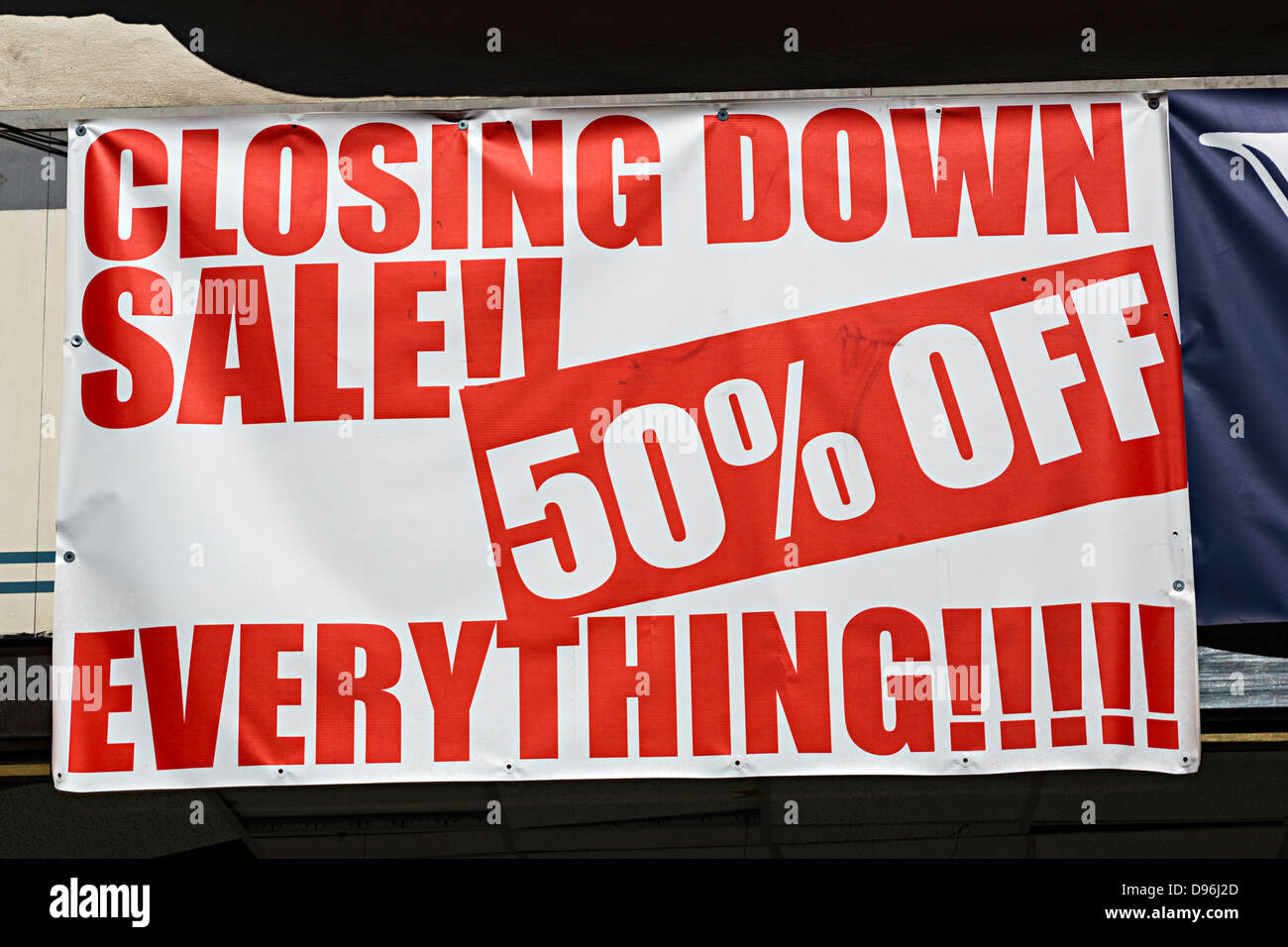 Closing down sale, 50% off everything, sign over shop window, UK - Stock Image