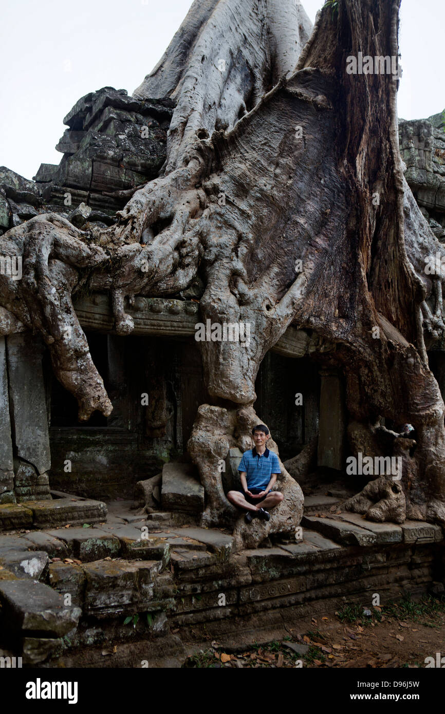 Tree root growing into the stucture of a temple in Preah Khan. Ankor Wat Cambodia - Stock Image