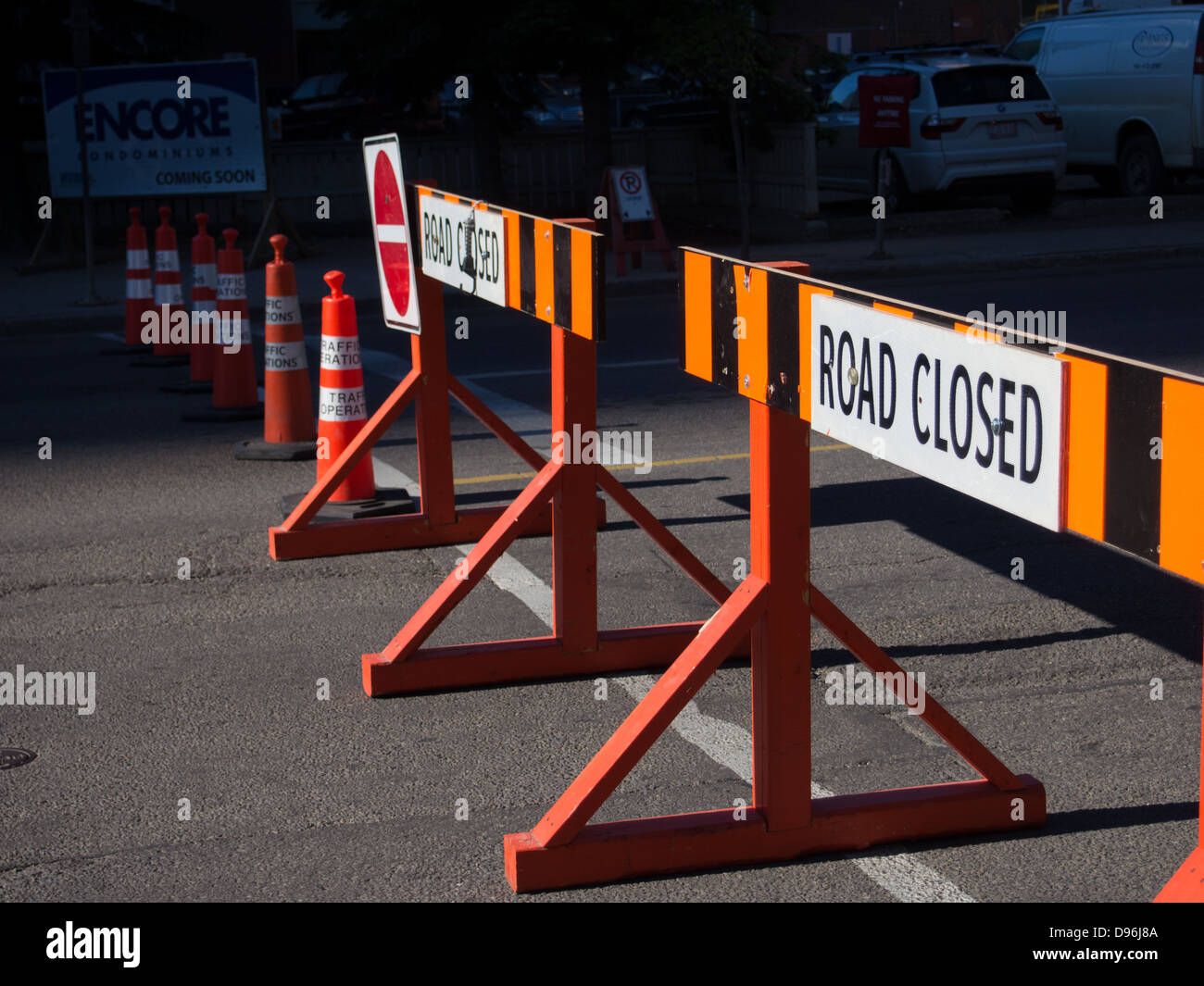 "road barriers reading ""road closed"" blocking road Stock Photo"
