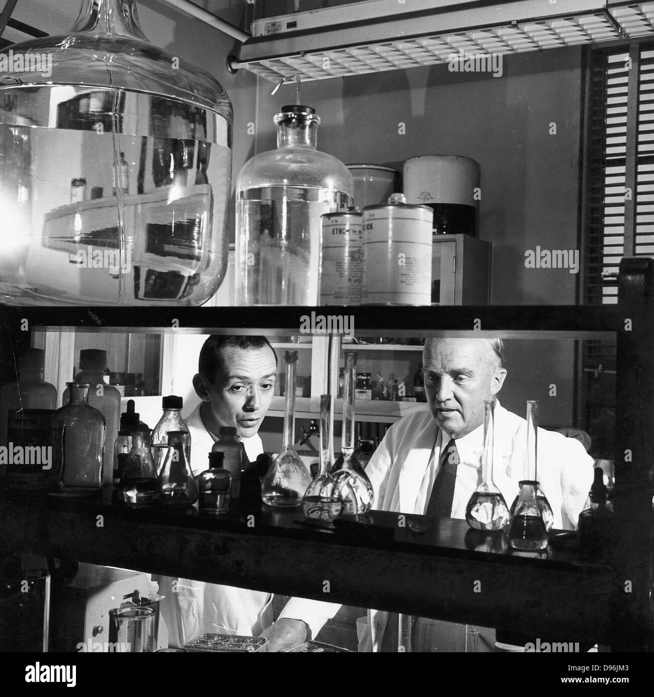 Charles Herbert Best (1899-1978) in the laboratory in 1960 with assistant (left) Canadian physiologist who assisted - Stock Image