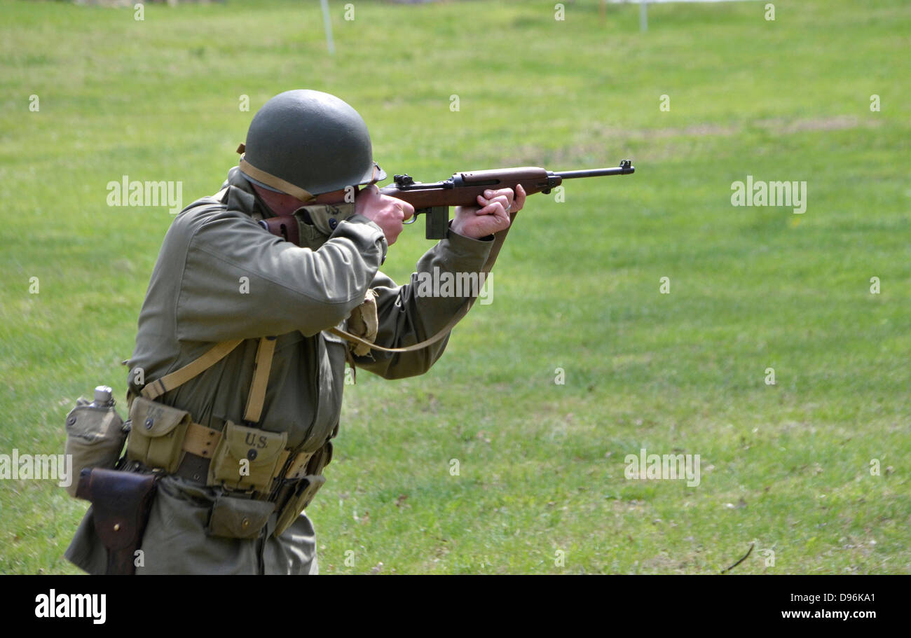 US soldier shooting an M! carbine during a WWII reenactment in Glendale, Maryland - Stock Image