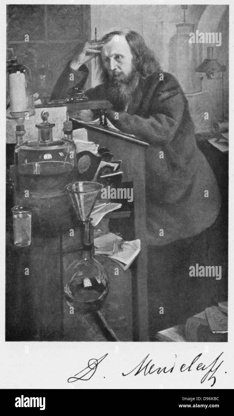 Dmitiri Ivanovich Mendeleyev (1834-1907), Russian chemist. Working at his desk. - Stock Image