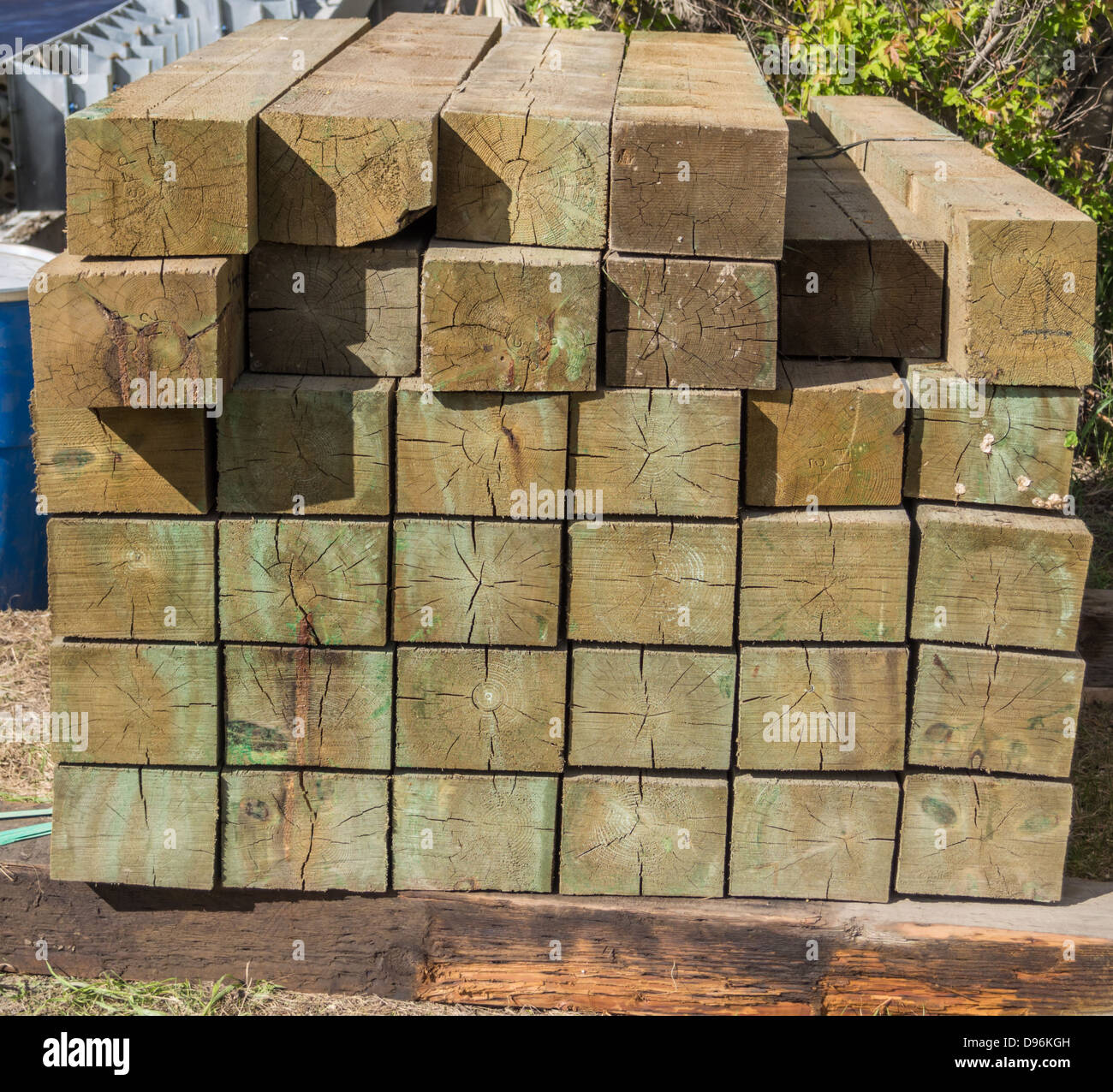 pile of stacked wood posts - Stock Image