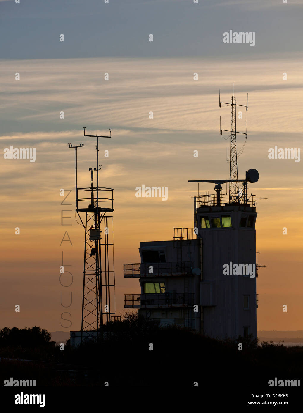 Roland Barthes inspired text and images. Zealous alongside semi-silhouette of coast guard radio tower. - Stock Image