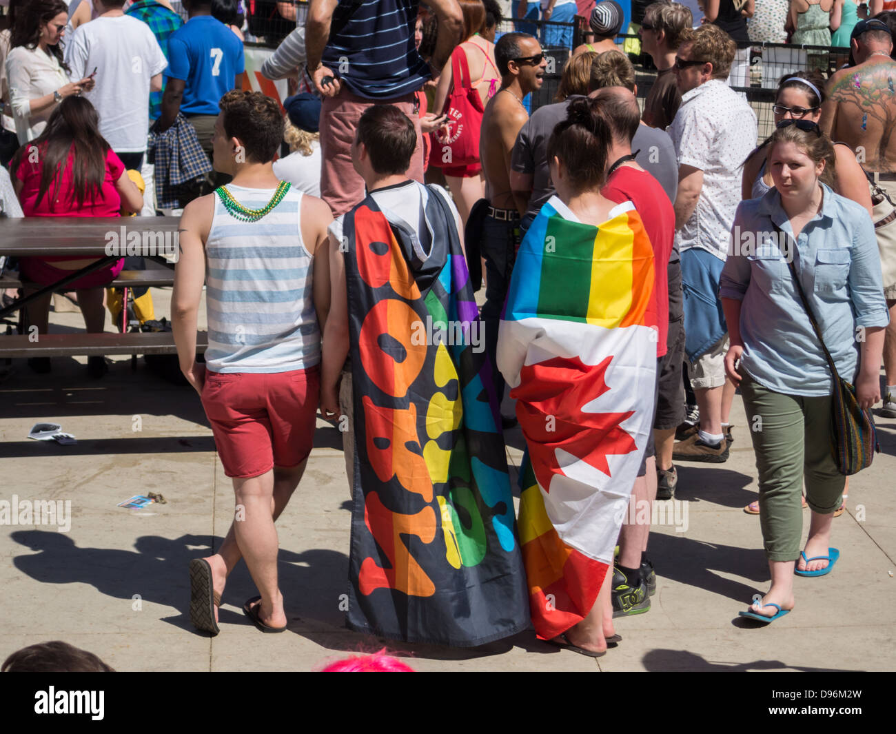 05562fb2dfc7 person wearing Canadian flag with pride colors at Edmonton Pride Festival
