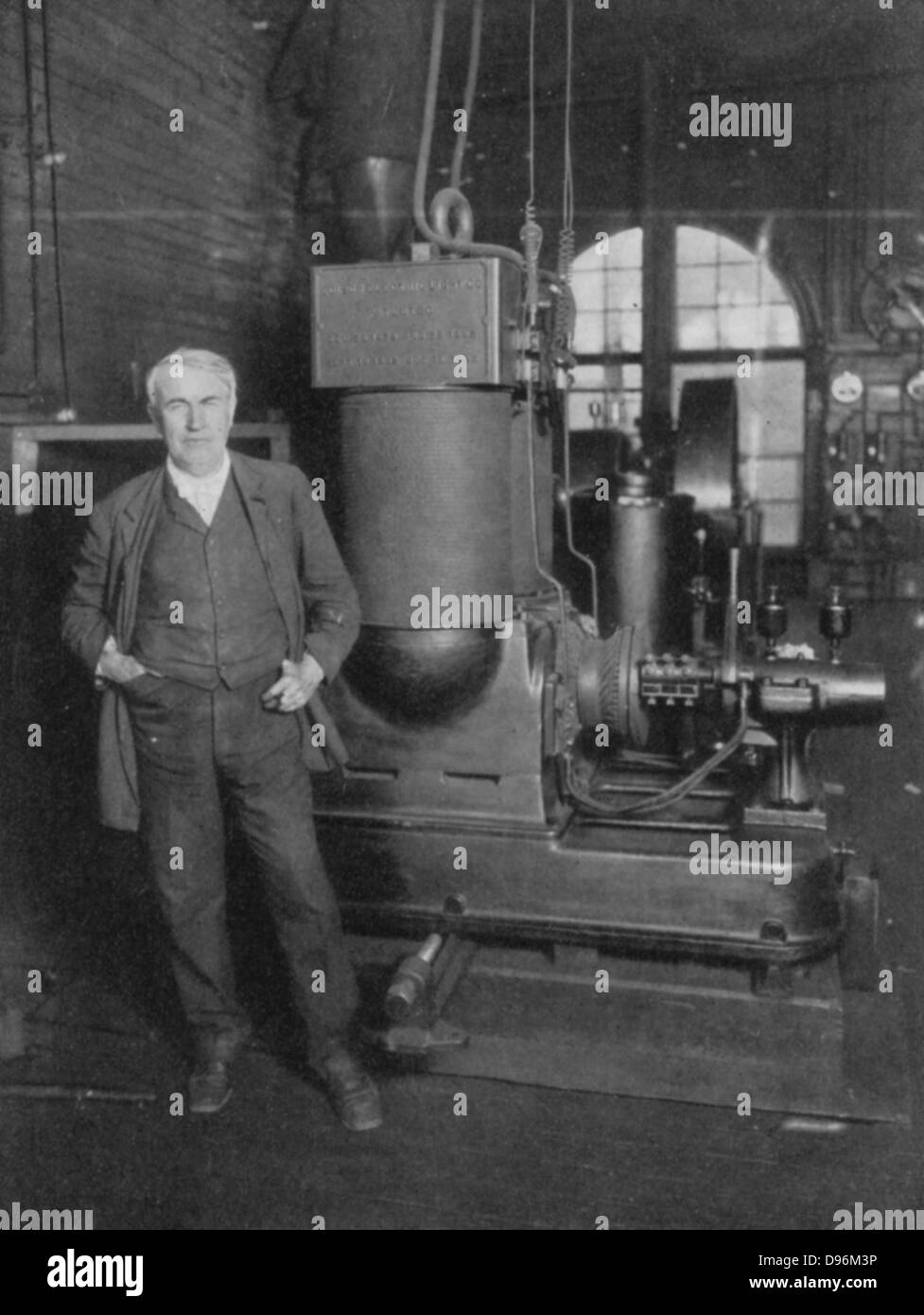 Thomas Alva Edison (1847-1931) American inventor, with his first dynamo for producing electric light. - Stock Image