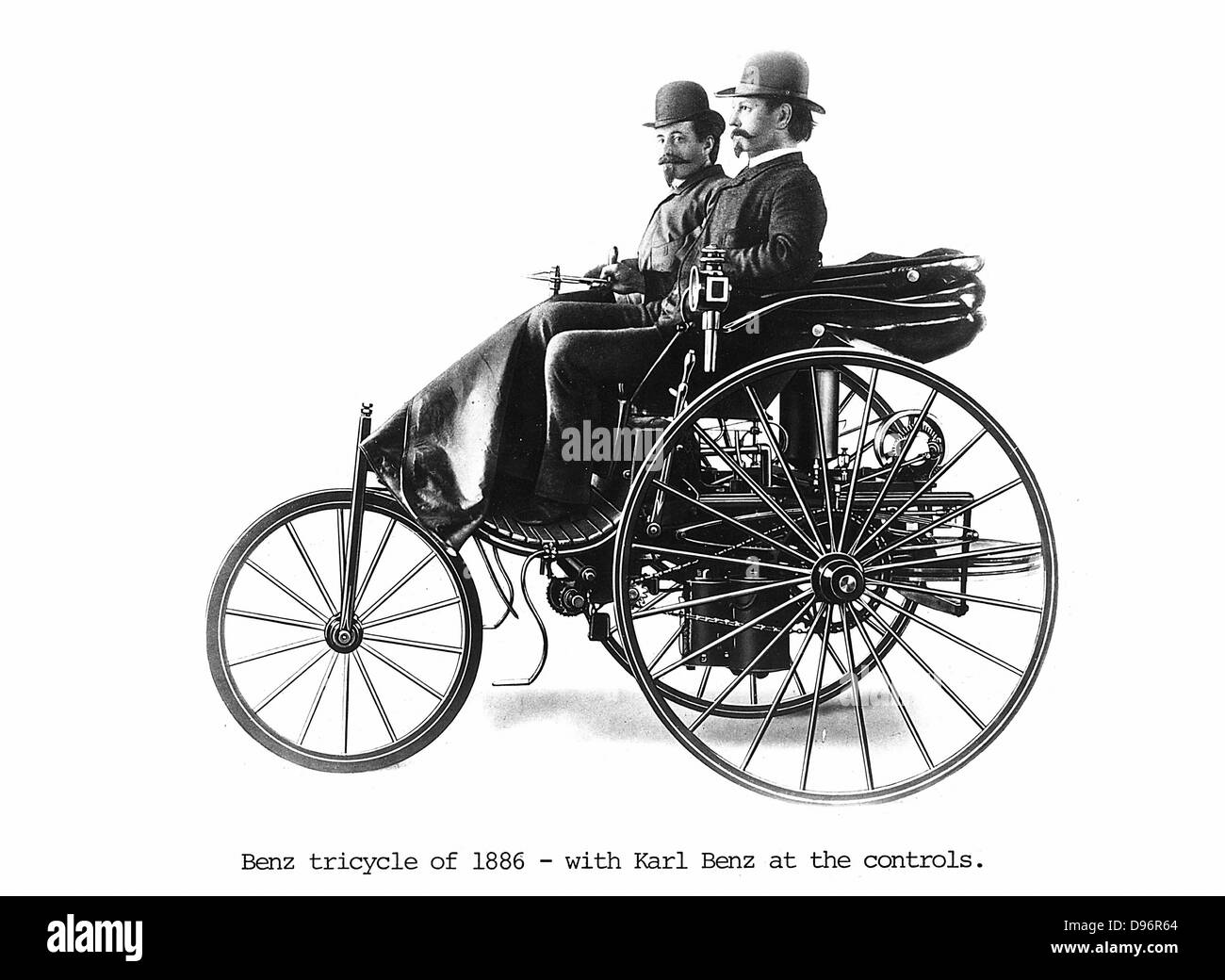 Benz tricycle of 1886 with Karl Benz (1844-1929), German engineer and car manufacturer, at the controls. - Stock Image