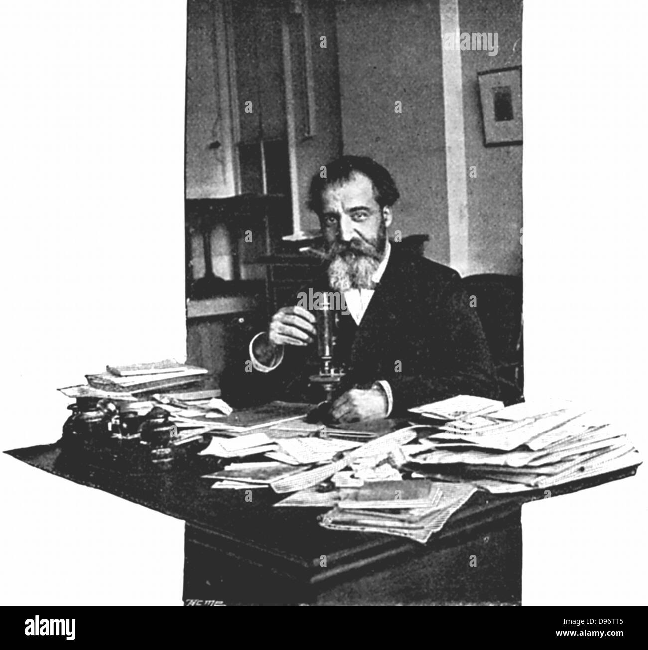 Henri Moissan (1852-1907) French chemist, at his desk at the Edison workshops, Paris, where he worked on the production - Stock Image