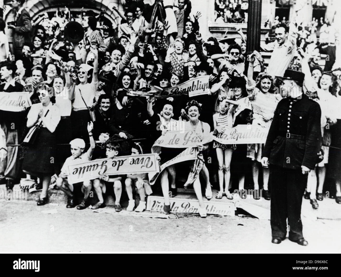 French civilians celebrating the Liberation of Paris in 1944. World War II. - Stock Image