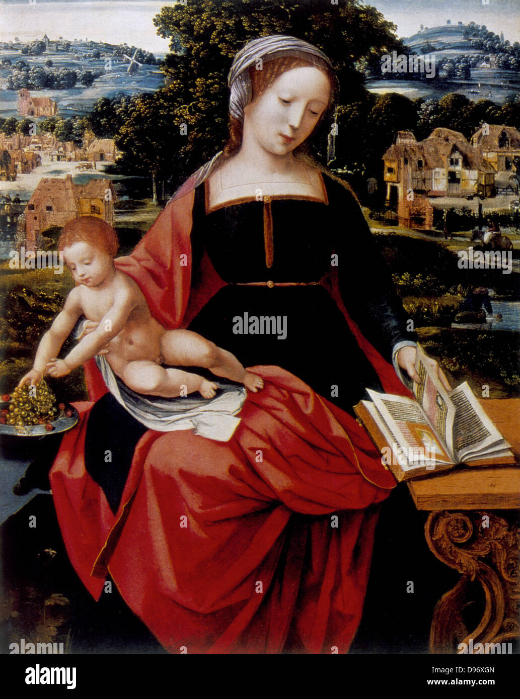Virgin and Child' Jesus on Mary's lap leans to take grapes from dish while Mary looks at illuminated devotional - Stock Image