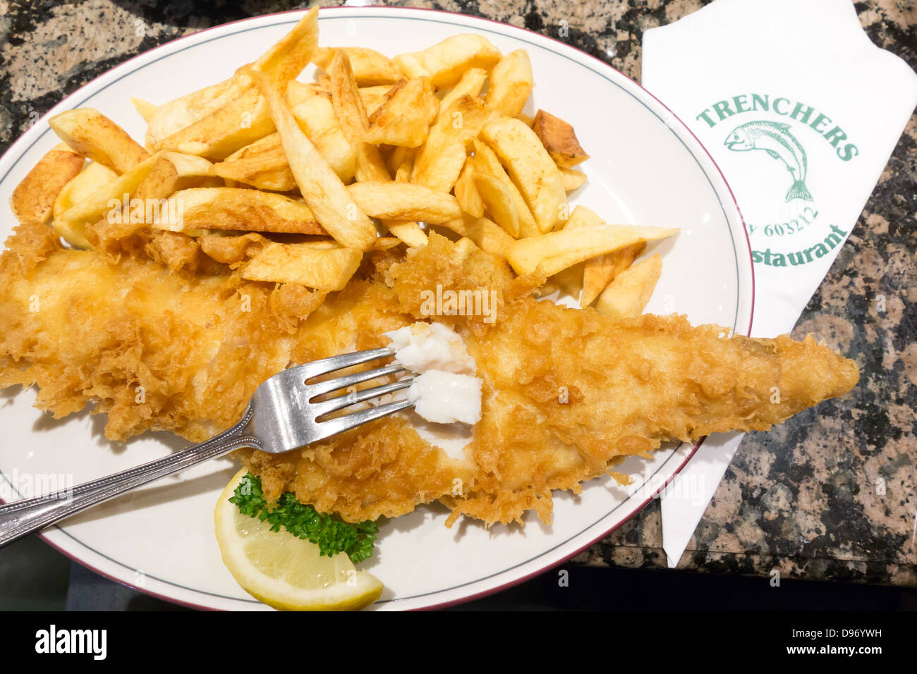 Excellent fish and chips at the famous Trenchers Café in Whitby - Stock Image