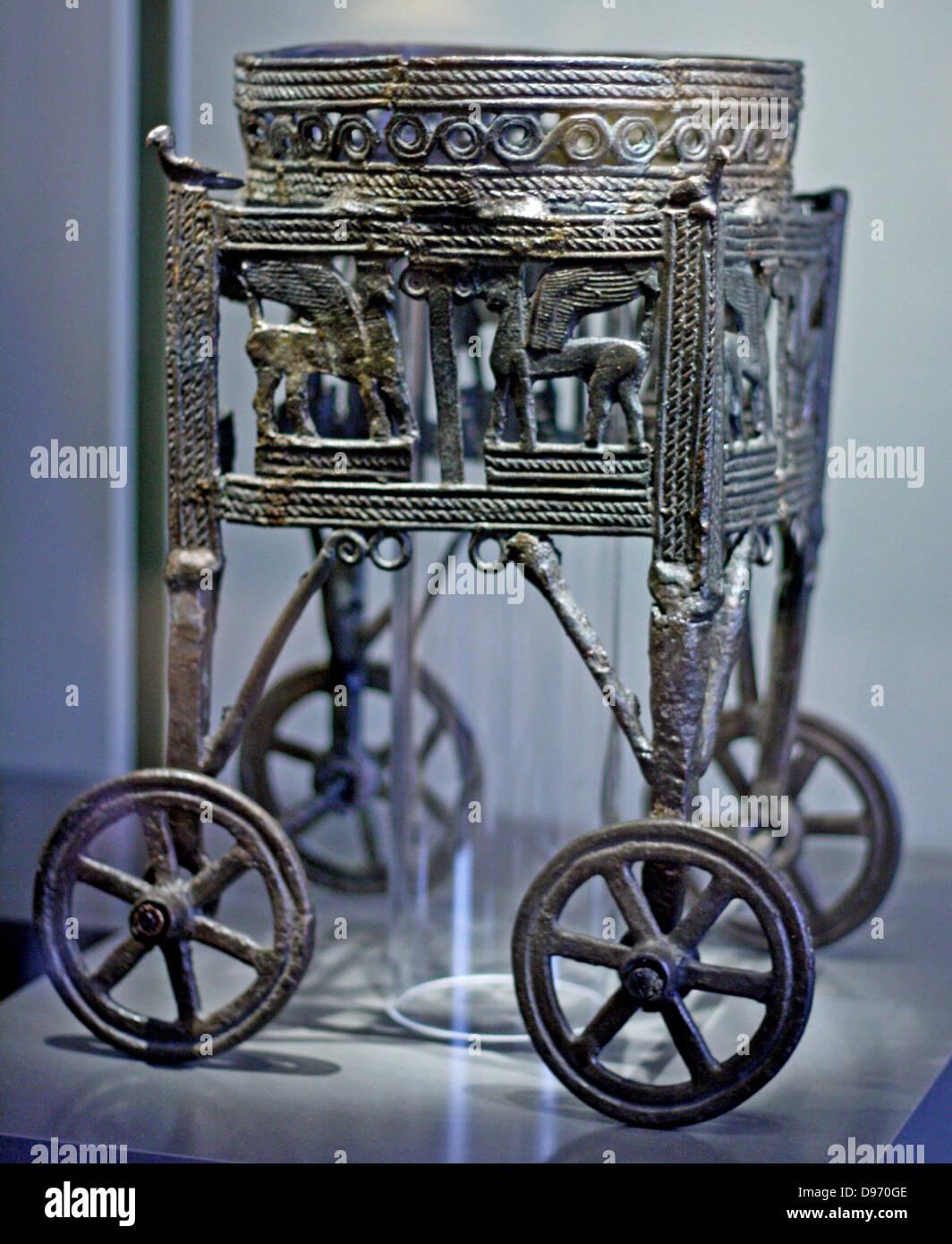 Wheeled bronze wagon built for a cauldron 12-11 th century BC from Larnaka Cyprus, Greek. Stock Photo