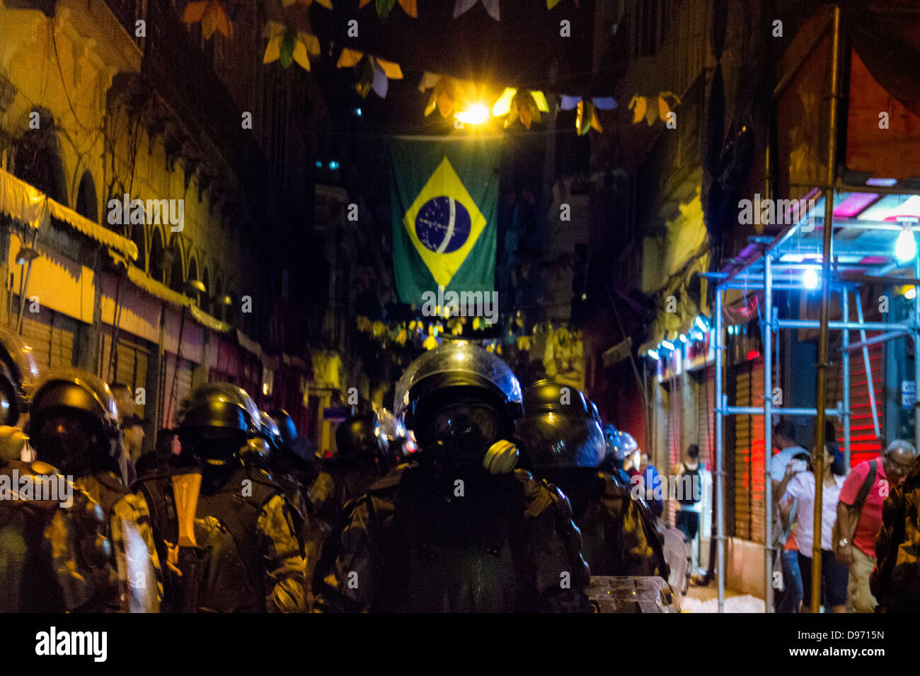 Army clash in the streets against protesters in public act against the increased bus fare in the city of Rio de - Stock Image