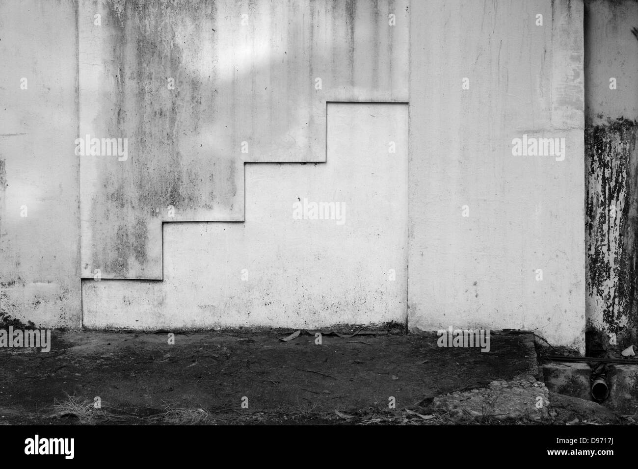 A stair like pattern on a decrepit wall, textures - Stock Image