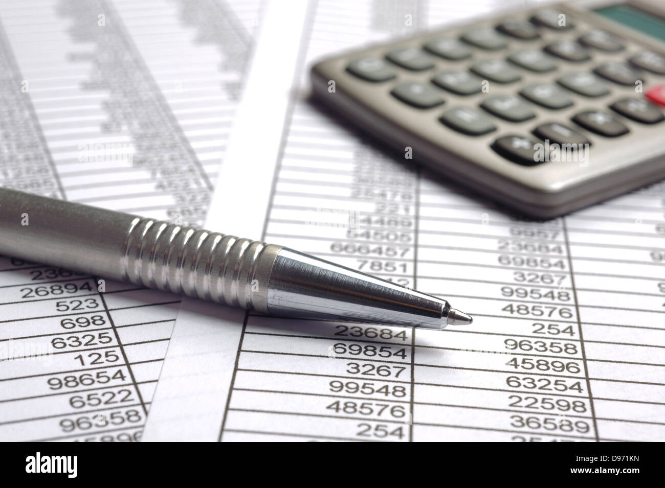 finance business calculation with pen and calculator - Stock Image