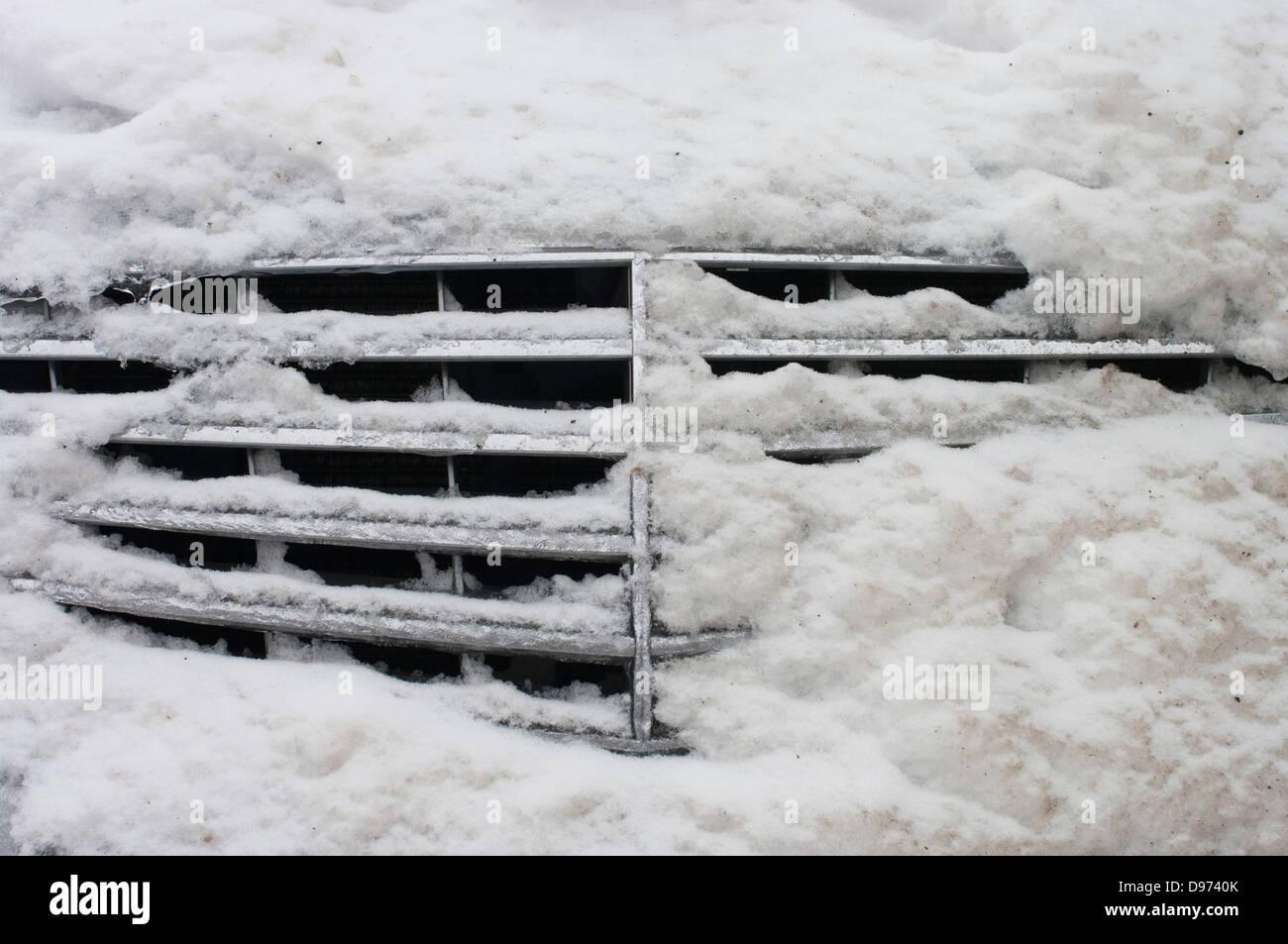 Germany, Hesse, Frankfurt, Snow on car radiator - Stock Image