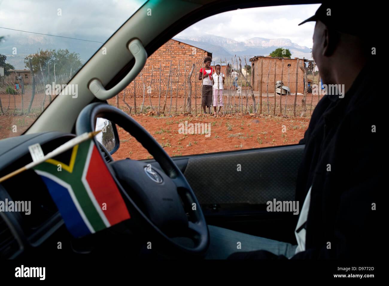 Fairbrigdge Seleka 48 drives though Burgerrecht village to pick up football fans transport them to Fan park in Eldorado - Stock Image