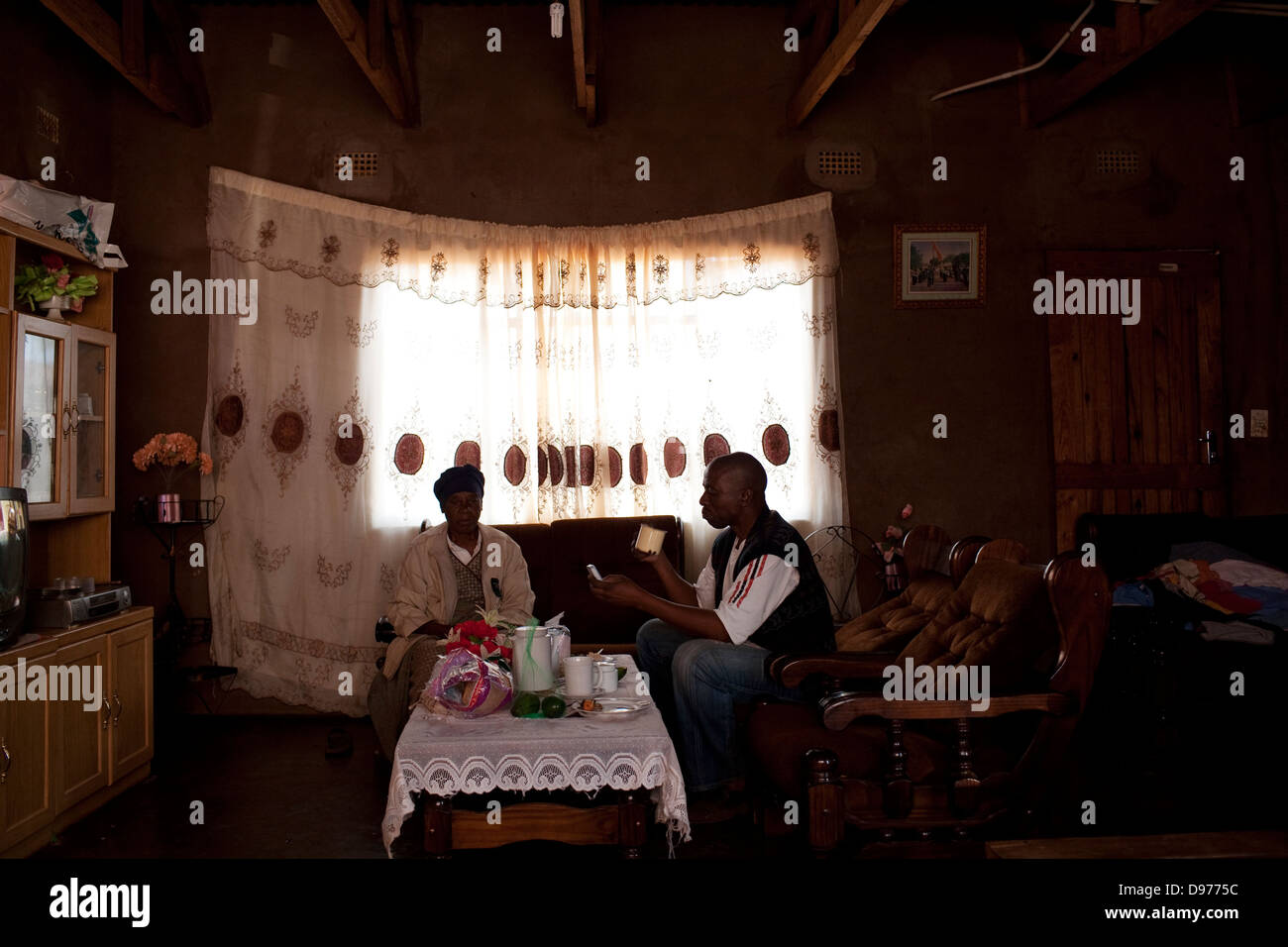 Taxi driver Fairbridge Seleka 48 drinking tea mother in home in Bochum district Limpopo South Africa Limpopo's - Stock Image