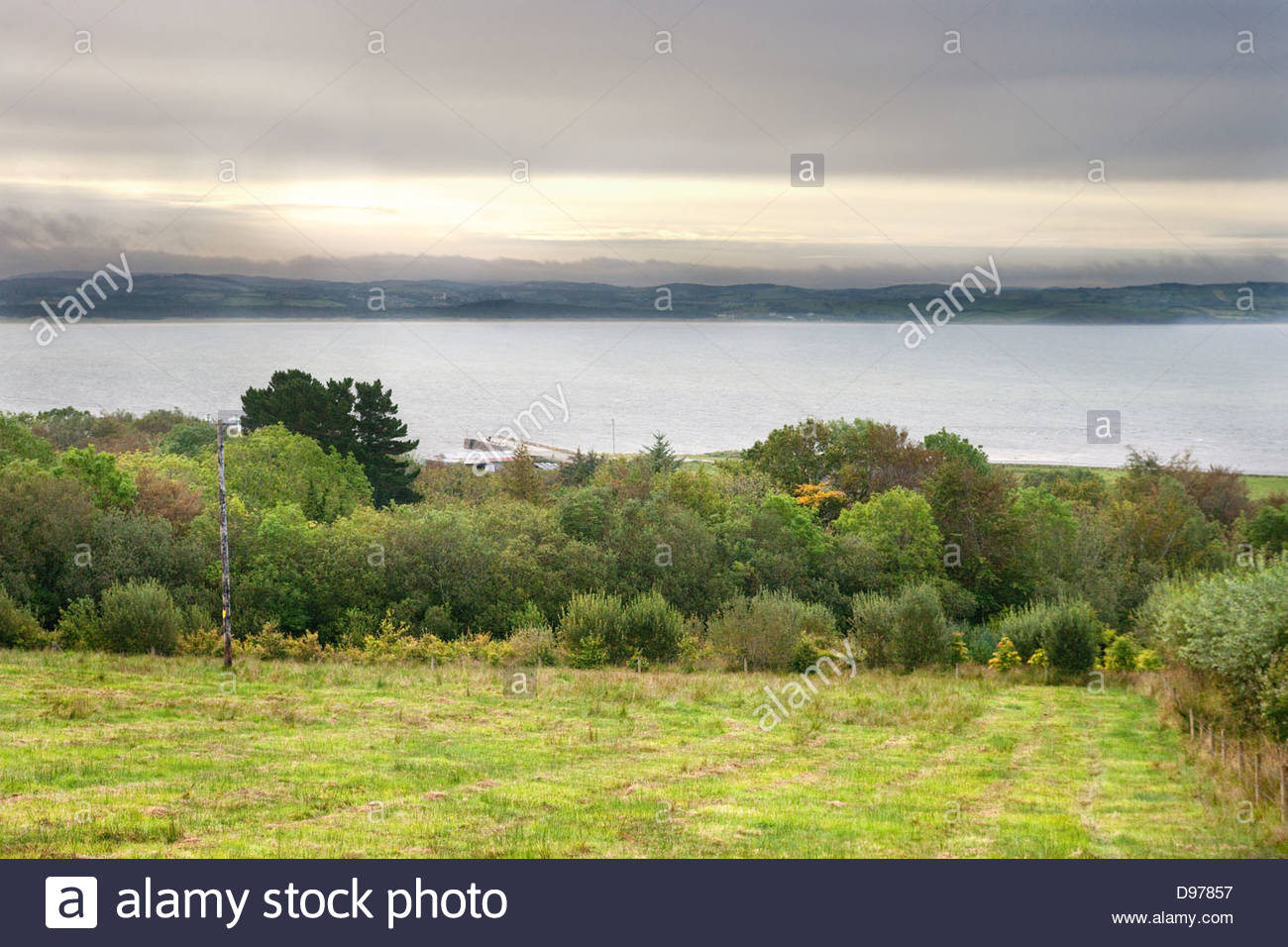 View over Salthill House gardens to the Irish Sea and Donegal Bay. - Stock Image