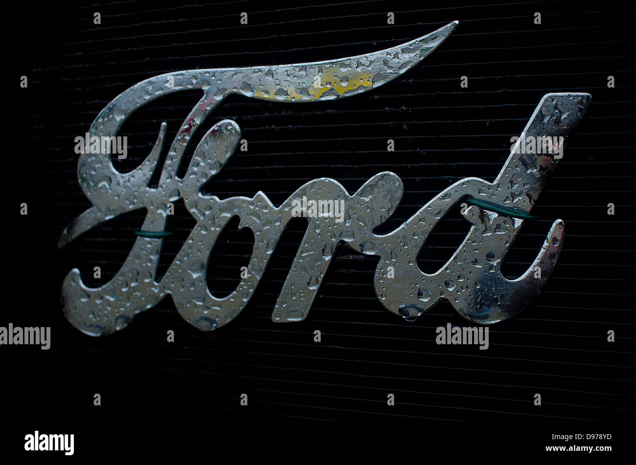 The Logo of Ford on the radiator of  the classic T Model with raindrops Stock Photo