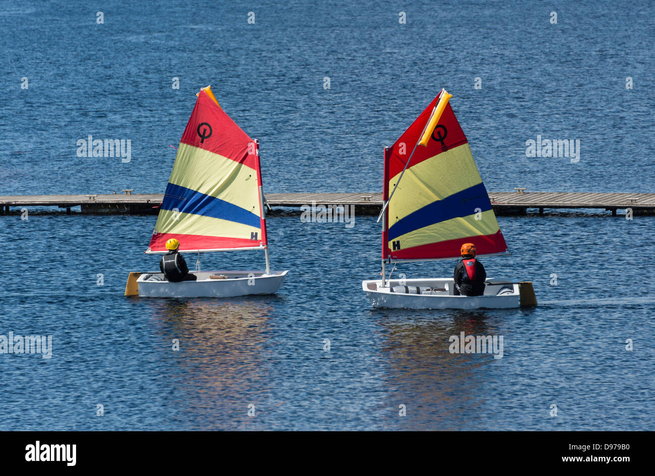 Youngsters practising yachting skills near the jetty at Kielder Water Sailing Club - Stock Image