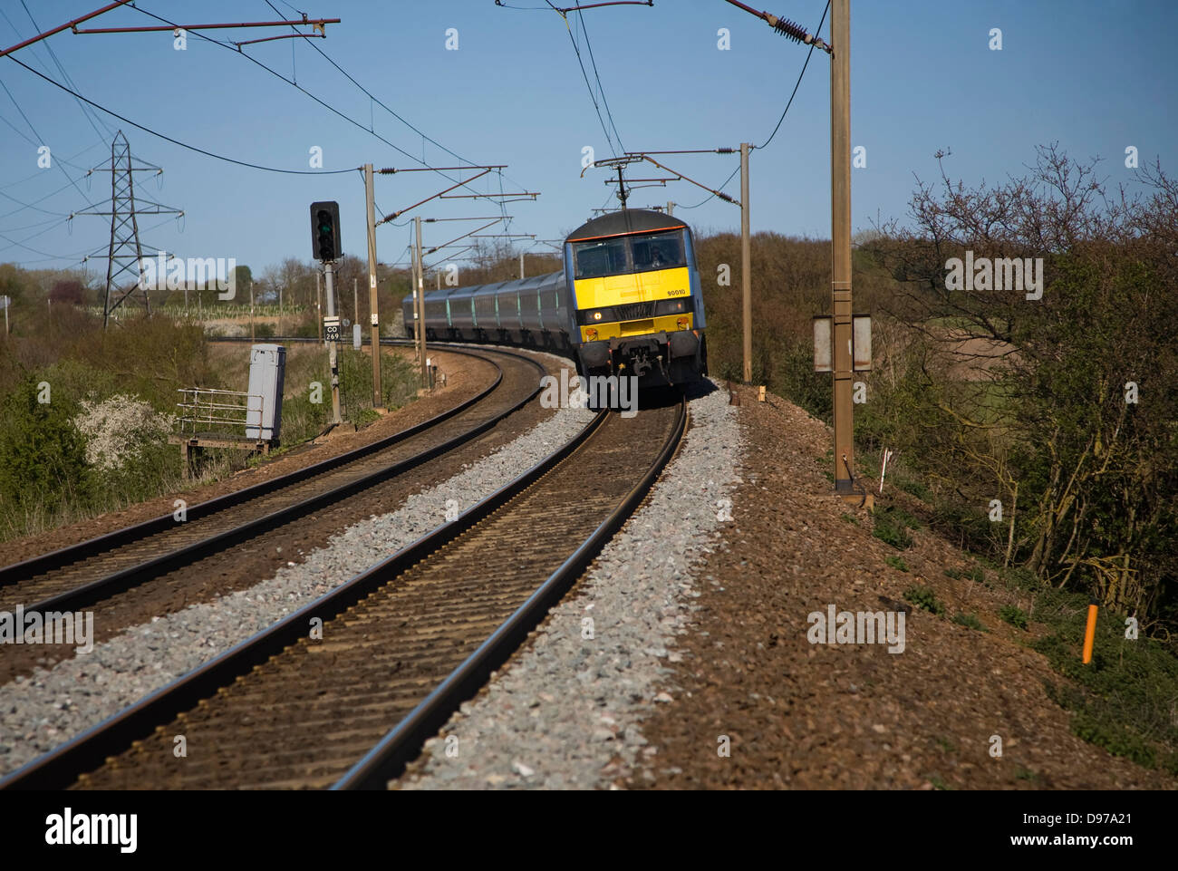 Greater Anglia Class 90 electric locomotive train on the Norwich to London line, England, UK - Stock Image