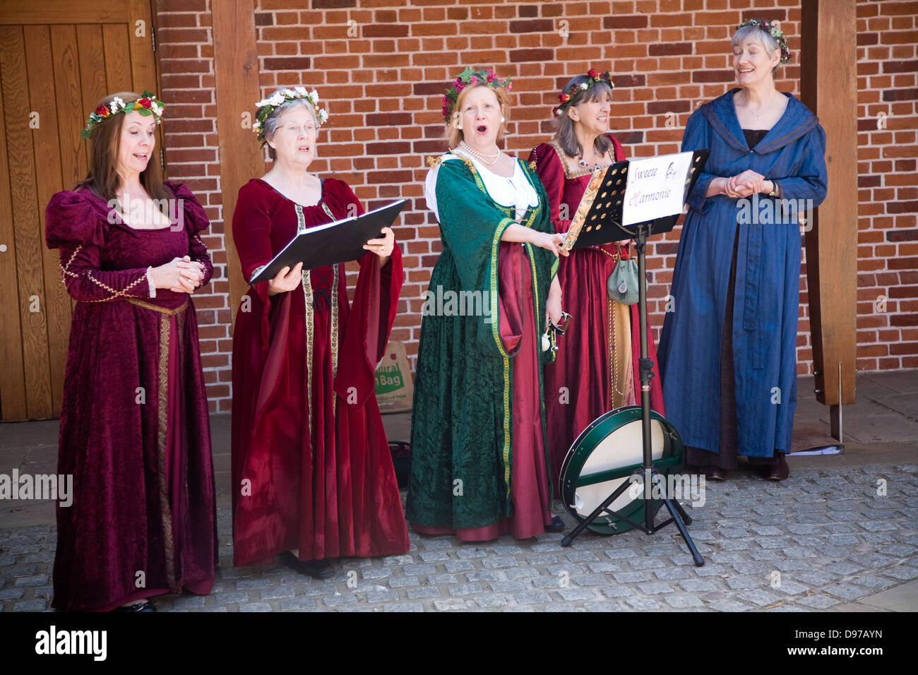 Sweet Harmonie female singing group in Tudor costume performing at Layer Marney Tower, Essex, England - Stock Image