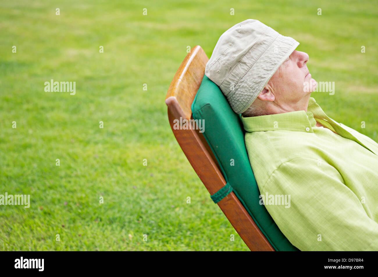 Seventies Man Retired - Snoozing - Stock Image