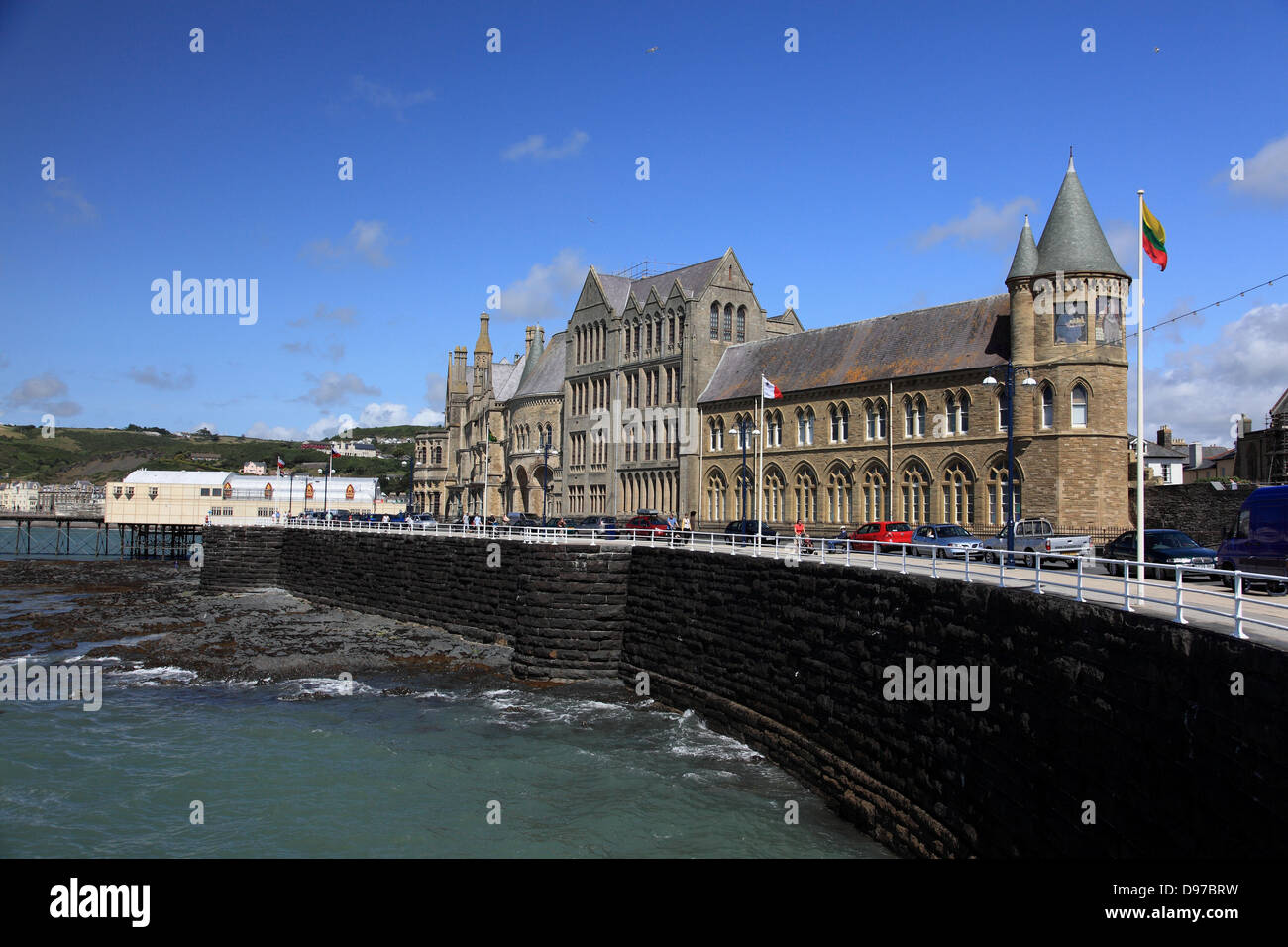 Old College, Aberystwyth, built in 1865, now just part of the University, and the pier, also built in 1865 - Stock Image