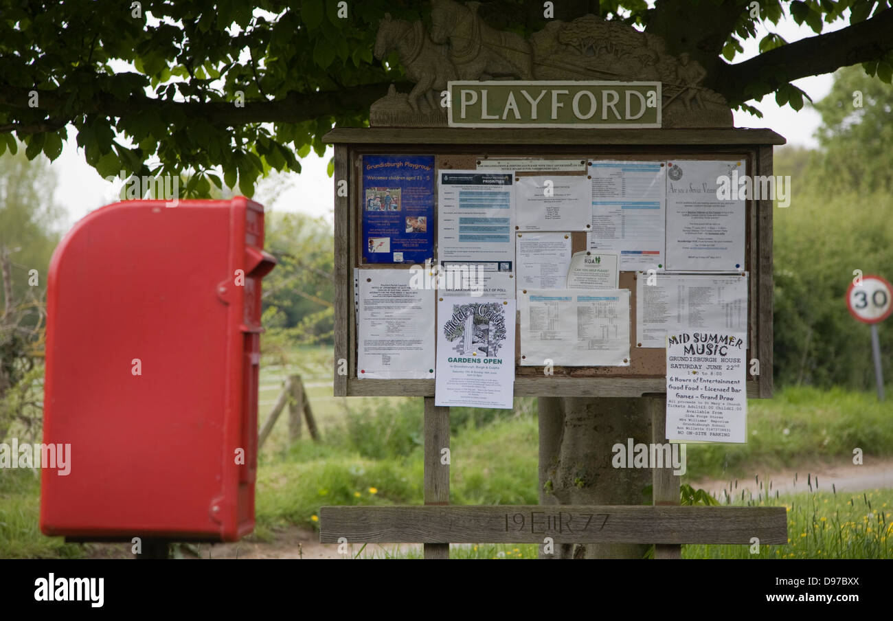 Small rural settlement services comprising of community noticeboard and post box, Playford, Suffolk, England - Stock Image