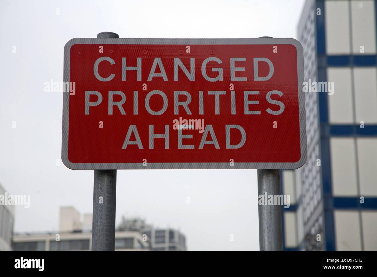 Sign for Changed Priorities Ahead Swindon, Wiltshire, England, UK - Stock Image
