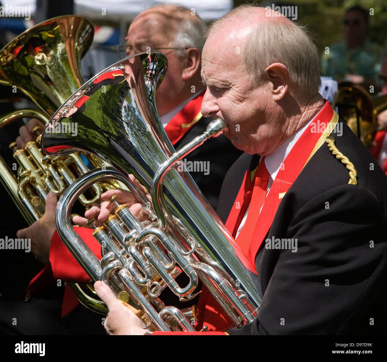 Musicians in a brass band perform during a country fair at Helmingham Hall, Suffolk, England - Stock Image