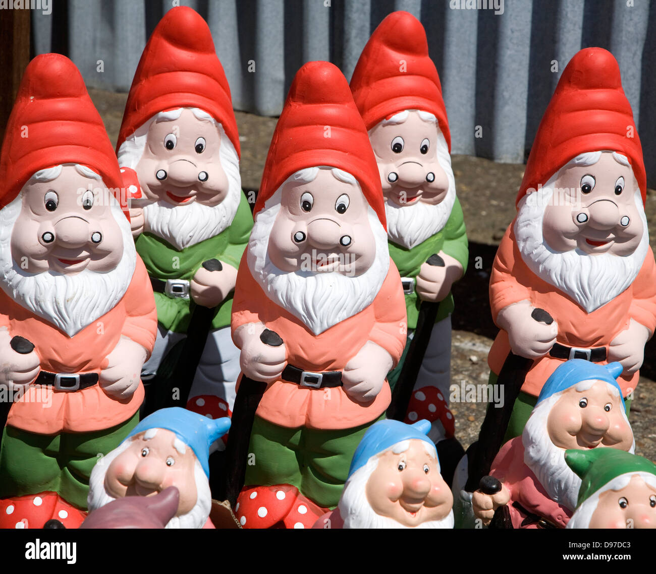 Colourful garden gnomes lined up for sale, UK - Stock Image