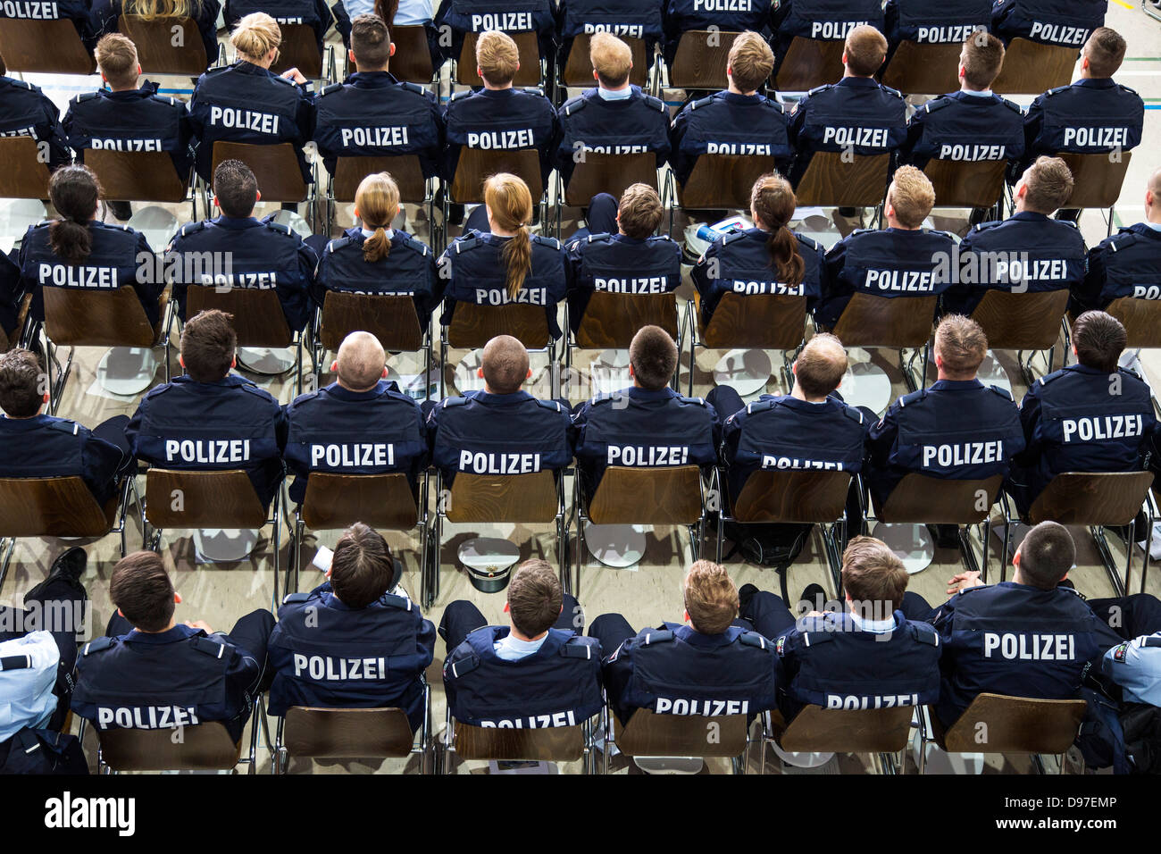 Police Commissioner candidates, trainees at the GermanPolice, sitting at a meeting in the auditorium. Stock Photo