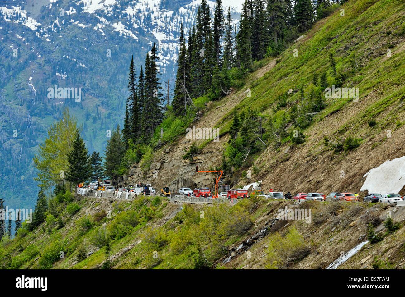 Road construction and traffic congestion near Logan Pass Glacier National Park Montana USA - Stock Image