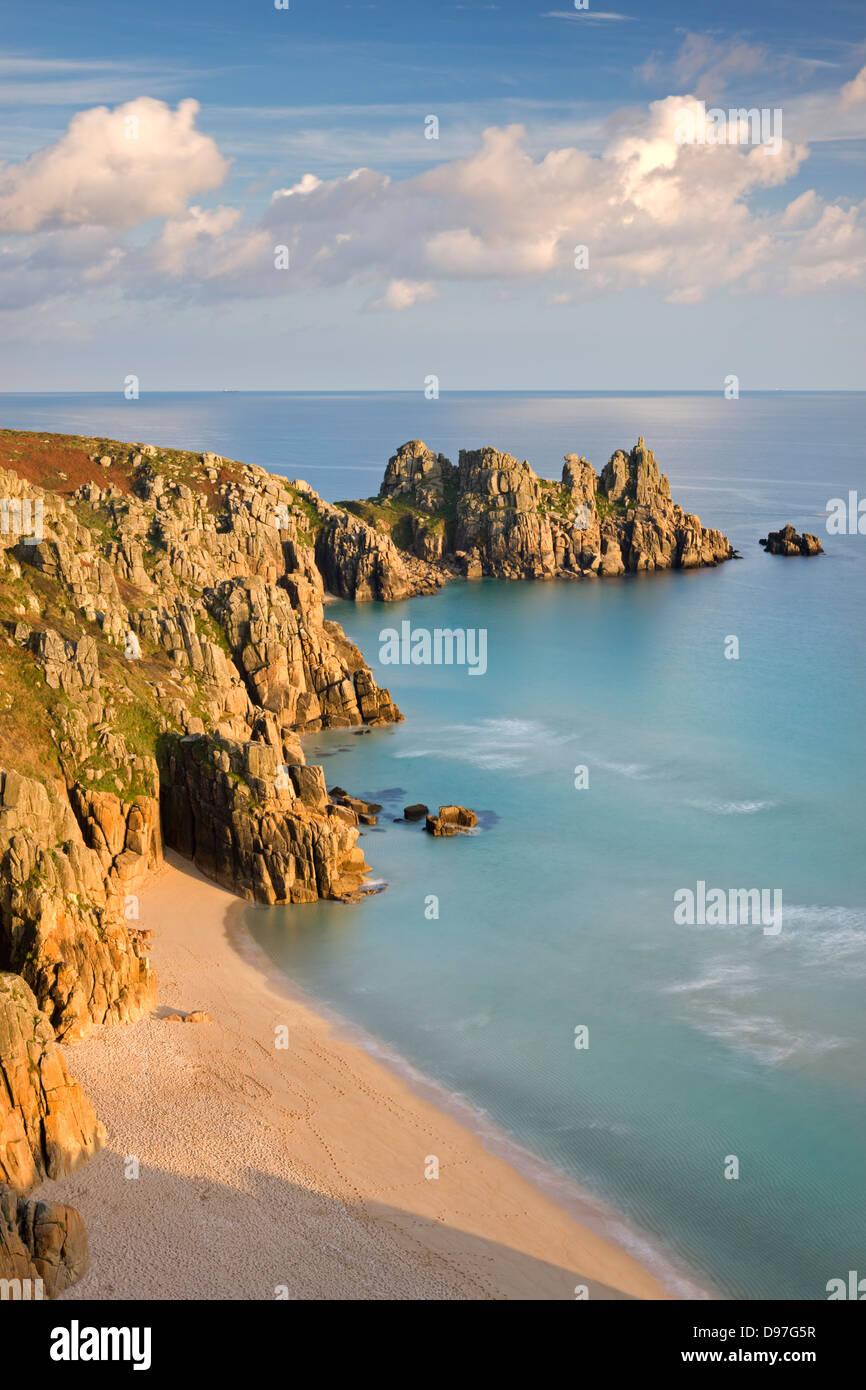 Pednvounder Beach backed by Logan Rock on Treryn Dinas headland, Porthcurno, Cornwall, England. - Stock Image